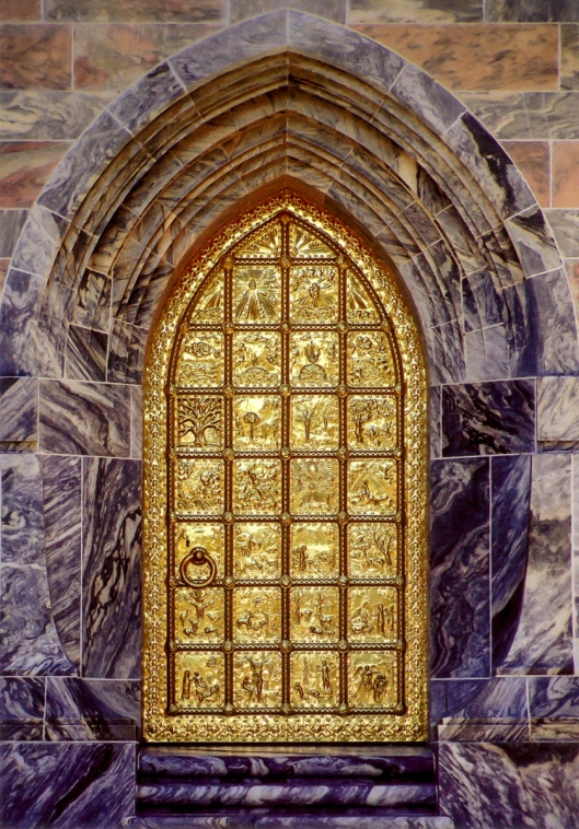 Postcard of the Bok Tower bras door showing the scenes of Creation on it.