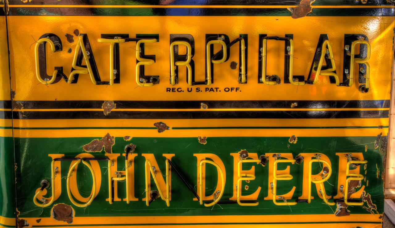 Caterpillar John Deere Sign at the Mecum Auto Auction ...
