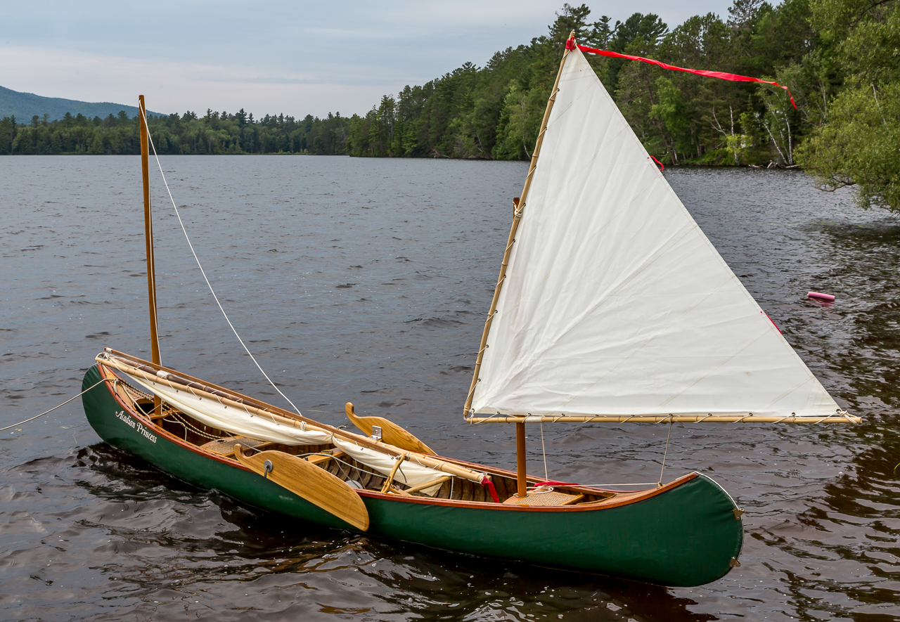 This Canvas Covered All Wooden Old Town Canoe Is Set Up For Sailing With Two Masts And Sails It Had Sideboards Instead Of A Central Centerboard
